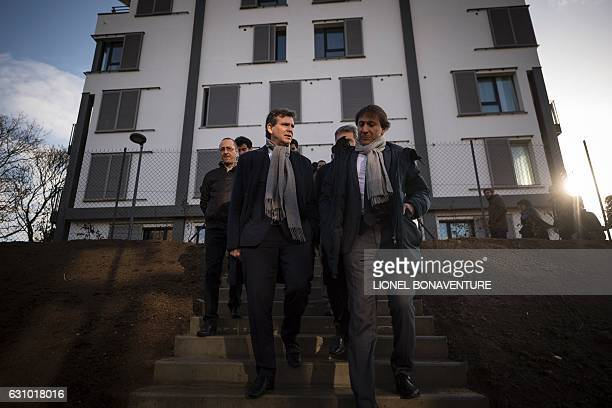 Former French economy minister and candidate in the leftwing primaries ahead of France's 2017 presidential election Arnaud Montebourg walks next to...