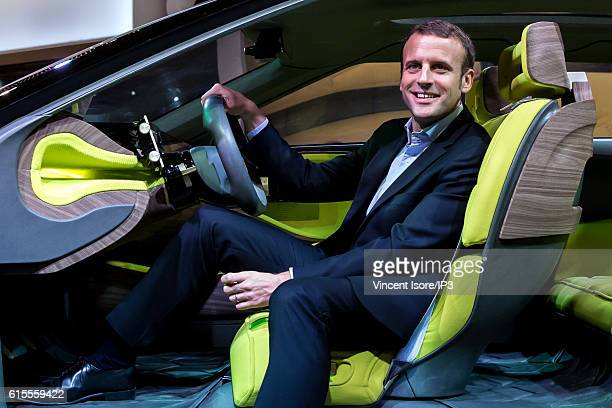 Former French Economy Minister and Founder and Leader of the political movement 'En Marche ' Emmanuel Macron tests a car on the PSA Peugeot Citroen...