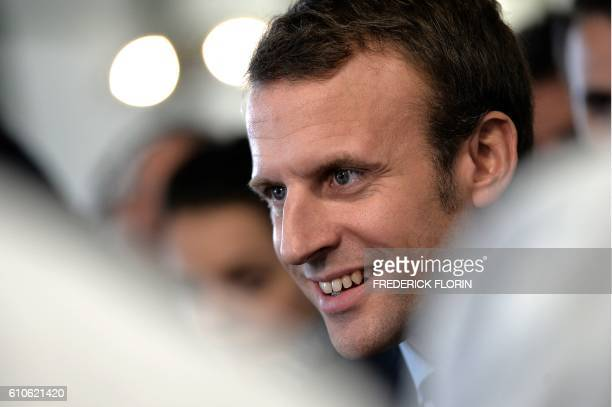 Former French Economy Minister and founder of the political movement 'En Marche' Emmanuel Macron addresses the media during a visit to the cooking...