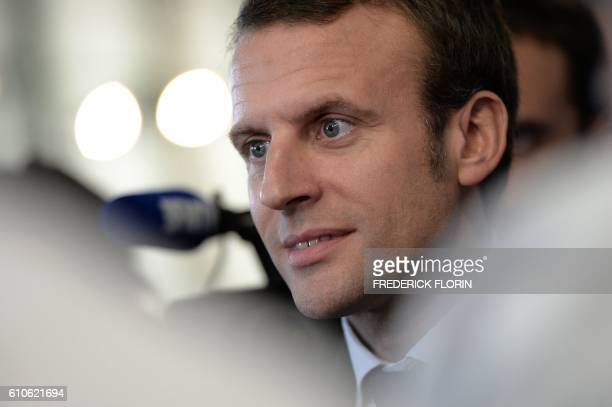 Former French Economy Minister and founder of the political movement 'En Marche' Emmanuel Macron addresses the media during a visit at the cooking...