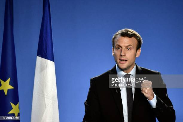 Former French Economy Minister Emmanuel Macron delivers a speech during a press conference to announce his candidacy for next year's presidential...