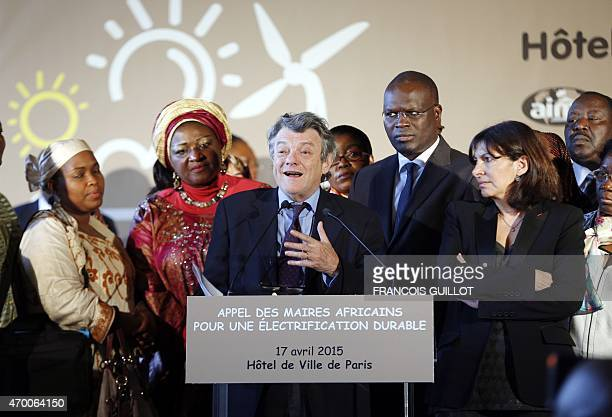 Former French Environment minister and President of the Fondation Energies pour l'Afrique JeanLouis Borloo delivers a speech as Paris Mayor Anne...