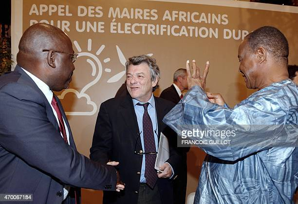 Former French Environment minister and President of the Fondation Energies pour l'Afrique JeanLouis Borloo greets Kinshasa mayor Guy Matondo and...
