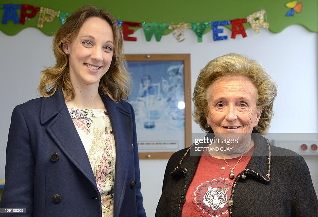 Former French First lady, Bernadette Chirac (R) poses beside the General Delegate of the 'Hopitaux de Paris', Danuta Pieter on January 9, 2013 at the Andre Mignot Hospital in Le Chesnay, west of Paris, during the launch of the 'Pieces Jaunes' (Small Coins) charity campaign's 24th edition.