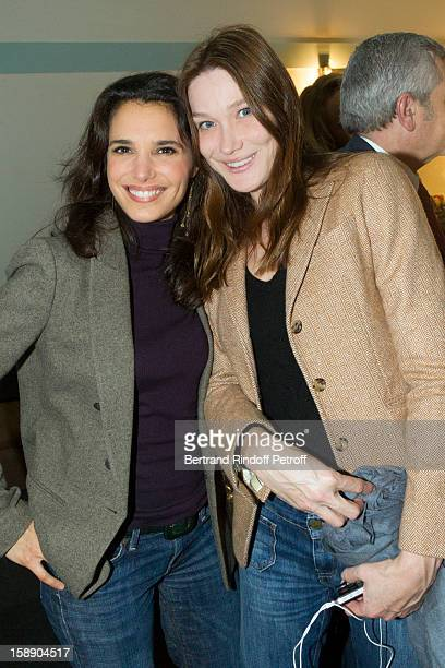 Former French First lady Carla Bruni-Sarkozy (R) and Ursula Freiss, the wife of actor Steohane Freiss, pose in French impersonator Laurent Gerra's dressing room following his one man show at Olympia hall on December 26, 2012 in Paris, France.