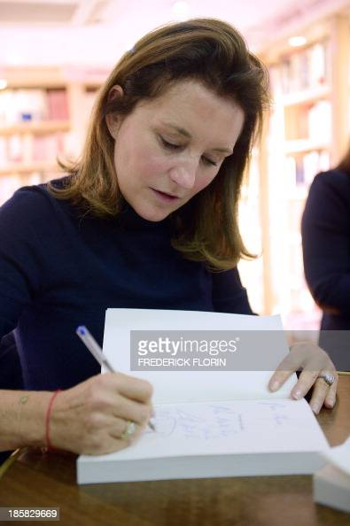 Former French first lady Cecilia Attias signs her book during the presentation of her recently published autobiography 'A Desire for The Truth' on...