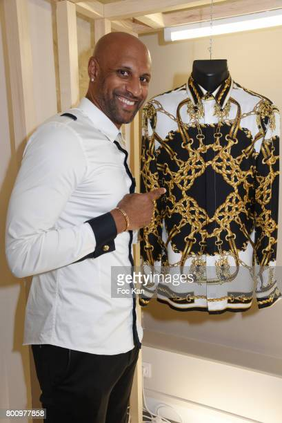 Former French football player Ousmane Dabo poses during the French Deal Cocktail as part of Paris Fashion Week on June 25 2017 in Paris France