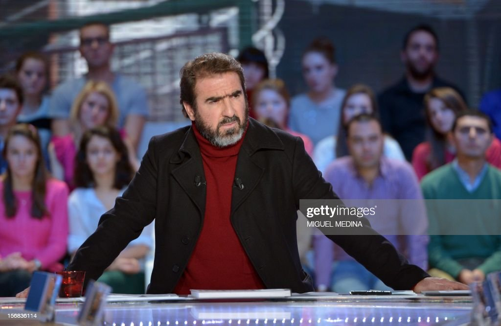 Former French football player turned actor Eric Cantona hosts the TV show 'Le grand journal' on a set of French TV Canal+, on November 22, 2012 in Paris, as part of the launching of French charity association Abbe Pierre Foundation's winter campaign.