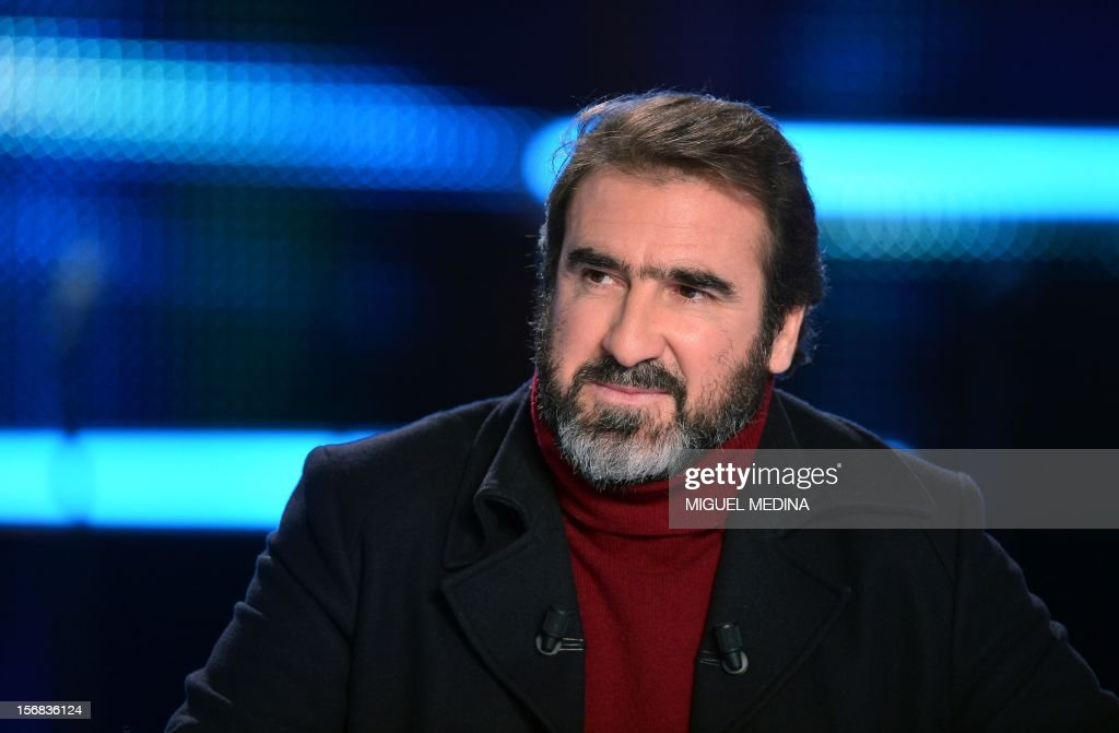 Former French football player turned actor Eric Cantona hosts the TV show 'Le grand journal' on a set of French TV Canal+, on November 22, 2012 in Paris, as part of the launching of French charity association Abbe Pierre Foundation's winter campaign. AFP PHOTO MIGUEL MEDINA