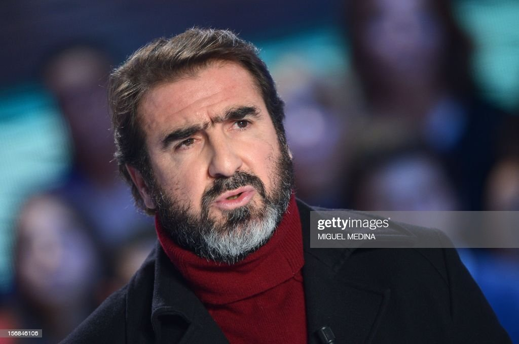Former French football player turned actor Eric Cantona hosts the TV show 'Le grand journal' on a set of French TV Canal+, on November 22, 2012 in Paris as part of the launching of the French chari...