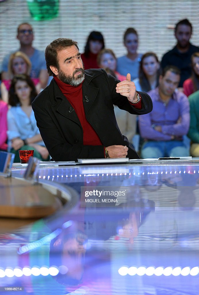 Former French football player turned actor Eric Cantona hosts the TV show 'Le grand journal' on a set of French TV Canal+, on November 22, 2012 in Paris as part of the launching of the French charity association Abbe Pierre Foundation's winter campaign. AFP PHOTO / MIGUEL MEDINA