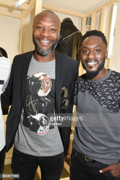 Former French Football player William Gallas and Designer Steeven Kodjia pose during the French Deal Cocktail as part of Paris Fashion Week on June...