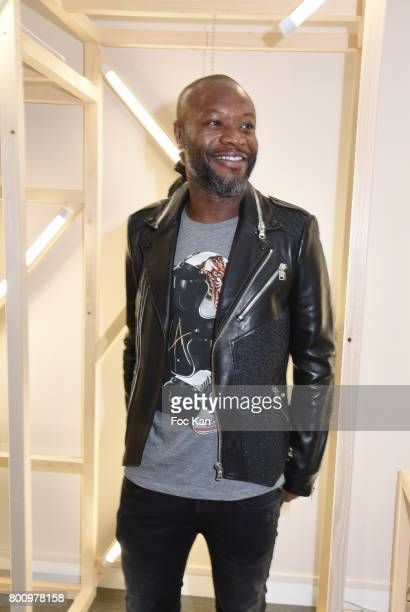 Former French Football player William Gallas poses with a leather and fish skin jacket during the French Deal Cocktail as part of Paris Fashion Week...