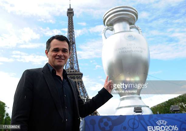 Former French football player Willy Sagnol poses next to an inflatable UEFA cup at the Champs de Mars on June 23 2013 in Paris France