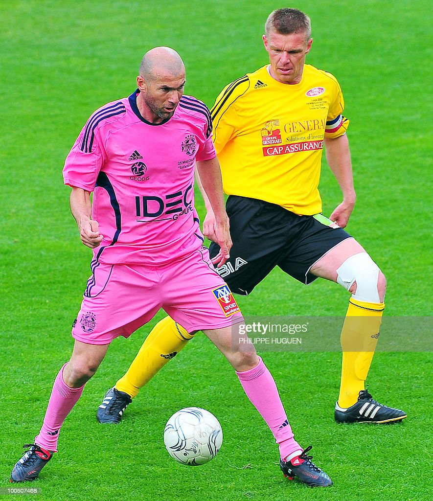 Former French football star Zinedine Zidane (L) vies with Calais' midfielder Thierry Vaillant during the football exhibition match Calais vs. Varietes Club de France, on May 25, 2010 at the Epopee stadium in Calais, northern France. This exhibition match between Calais and a team made up of French 1998 World Cup champions stands to commemorate amateur team of Calais epic run to the final of the 2000 Coupe de France.