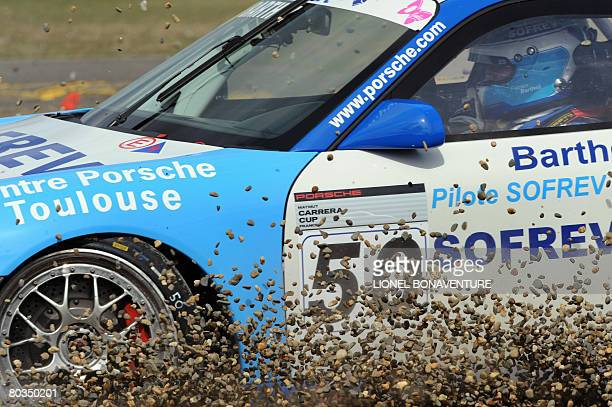 Former French football team goalkeeper Fabien Barthez slides off with his car in the first curve of the Nogaro ring during the Porsche Carrera Cup...