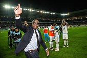 Former French footballer Basile Boli waves to supporters at the end of the French Cup semifinal football match between Sochaux and Marseille at...
