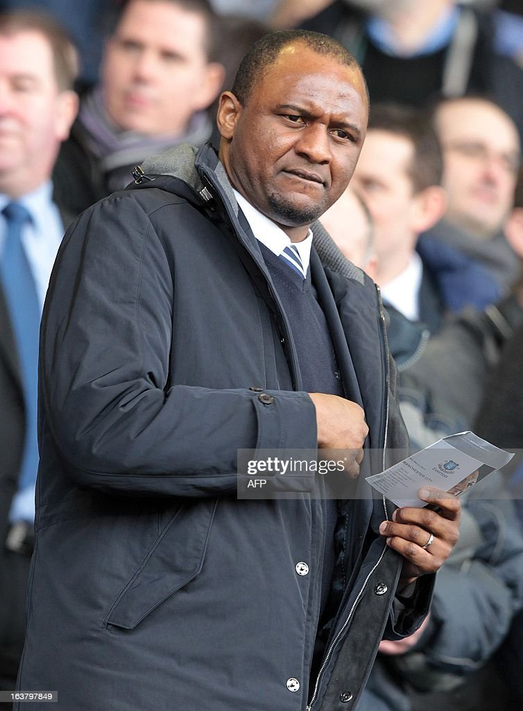Former French footballer Patrick Vieira watches an English Premier League football match between Everton and Manchester City at Goodison Park Stadium in Liverpool, north west England, on March 16, 2013. USE. No use with unauthorized audio, video, data, fixture lists, club/league logos or 'live' services. Online in-match use limited to 45 images, no video emulation. No use in betting, games or single club/league/player publications.