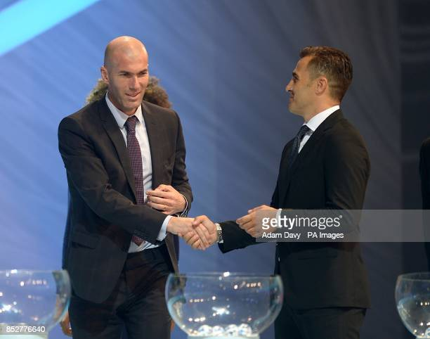 Former French footballer Zinedine Zidane shakes hands with Former Italian footballer Fabio Cannavaro during the FIFA 2014 World Cup Draw at the Costa...