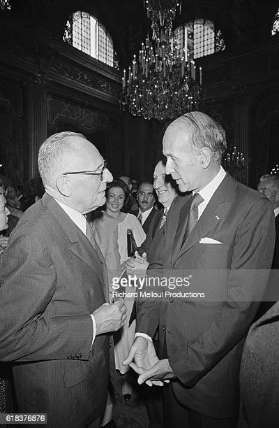 Former French Foreign Minister and journalist Maurice Schumann meets French President Valery Giscard d'Estaing at a garden party in honor of...