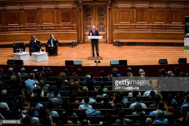 Former French Foreign Minister Laurent Fabius delivers a speech as French President Emmanuel Macron and former UN SecretaryGeneral Ban Kimoon listen...