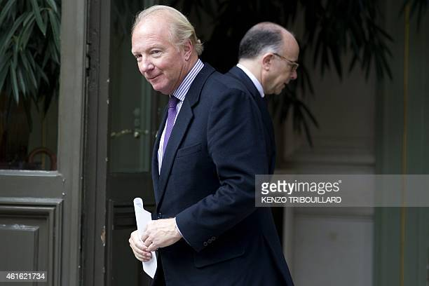 Former French Interior Minister Brice Hortefeux leaves after a meeting with French Interior minister Bernard Cazeneuve on January 16 2015 at the...