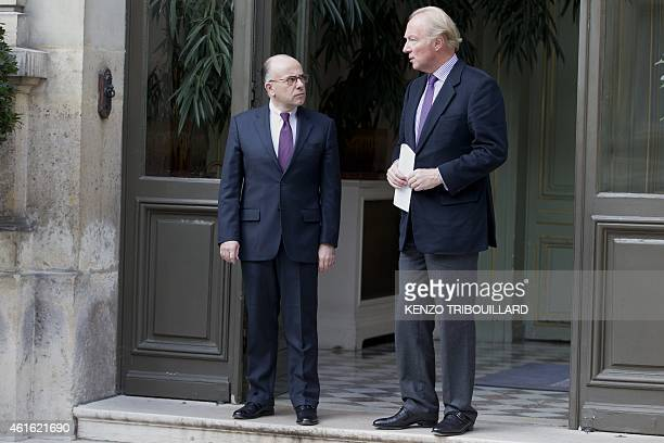 Former French Interior Minister Brice Hortefeux poses with French Interior minister Bernard Cazeneuve after a meeting on January 16 2015 at the...