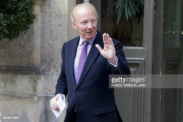 Former French Interior Minister Brice Hortefeux waves as he leaves after a meeting with French Interior minister on January 16 2015 at the Ministry...