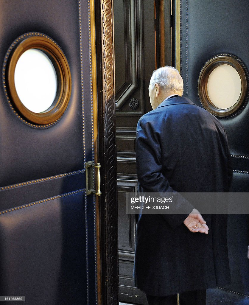 Former French Interior minister Charles Pasqua enters a courtroom, on February 11, 2013 at Paris' courthouse in Paris, prior to a hearing of the appeal trial of the so-called oil for food programm case where he is facing charges of corruption and influence peddling . AFP PHOTO MEHDI FEDOUACH