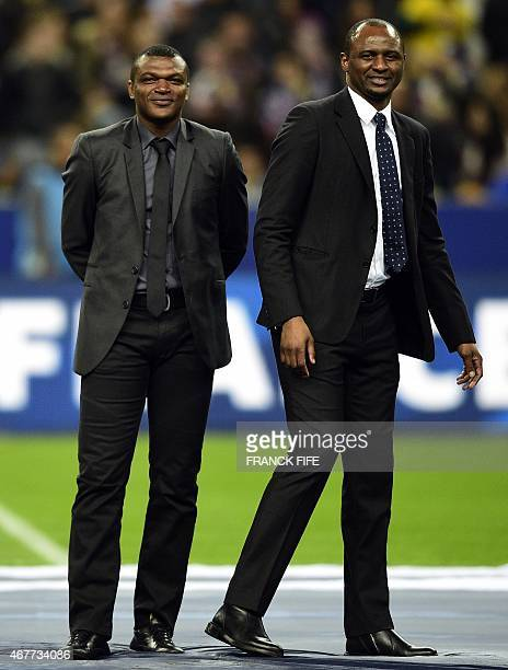Former French international football players Marcel Desailly and Patrick Vieira take part in a ceremony honouring French former international...