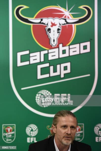 Former French international footballer Emmanuel Petit speaks during an interview after the first draw for the upcoming season's EFL Cup football...