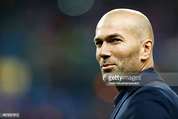 Former French international Zinedine Zidane walks on the field prior to the International Friendly match between France and Brazil at the Stade de...