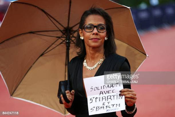 Former French journalist and current President of the Foundation for Nature and Man Audrey Pulvar poses on the red carpet before the screening of the...