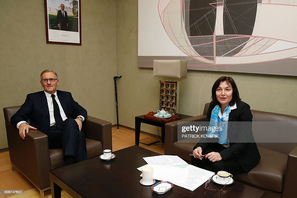Former French Junior minister in charge of developement and francophonie Annick Girardin (R) sits next to Andre Vallini, named as new French Junior minister of foreign affairs and international developement in charge of developement and francophonie on February 12, 2016 in Paris during the transferal of powers. French President Francois Hollande reshuffled his cabinet on February 11, 2016, naming Jean-Marc Ayrault foreign minister and adding several ecologists to government as he seeks to widen his political base ahead of a presidential poll in 2017. AFP PHOTO / PATRICK KOVARIK / AFP / PATRICK KOVARIK