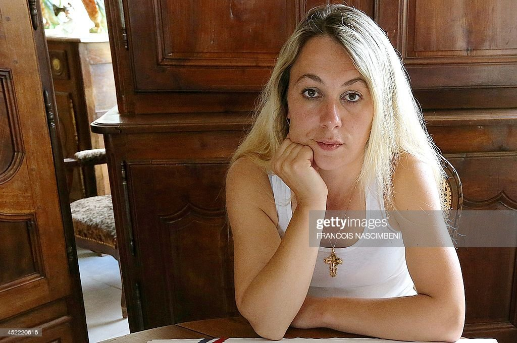 Former French local election candidate for the far-right National Front (FN) party Anne-Sophie Leclere, 33, poses at her home on July 16, 2014 in Rethel, northeastern France. On July 15, Leclere was sentenced to nine months in prison and five years of ineligibility for comparing French Justice minister Christiane Taubira to a monkey during a report broadcasted on October 17, 2013 on the public television channel France 2. The FN had reacted by 'suspending' Leclere's candidacy. Cayenne's criminal court (in French Guiana) added a fine of 50.000 euros to the sentence, and also condemned the FN party to pay a fine of 30.000 euros.