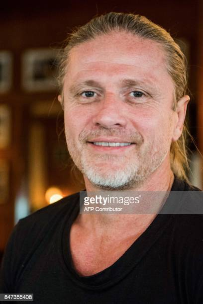 Former French midfielder and 1998 World Champion Emmanuel Petit poses during a photo session on September 14 2017 in Paris Challenged Arsenal head...
