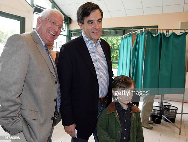 Former French minister and political advisor to Nicolas Sarkozy Francois Fillon next to his son Arnaud and Solesmes Mayor Roger Server arrives in a...