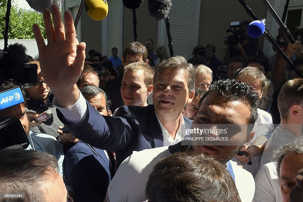 Former French Minister Arnaud Montebourg gestures as he arrives at the 44th annual Fete de la Rose political meeting on August 21 2016 in...