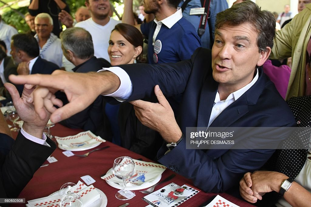 Former French Minister Arnaud Montebourg gestures next to Former French Minister of Culture Aurelie Filippetti at the 44th annual Fete de la Rose...