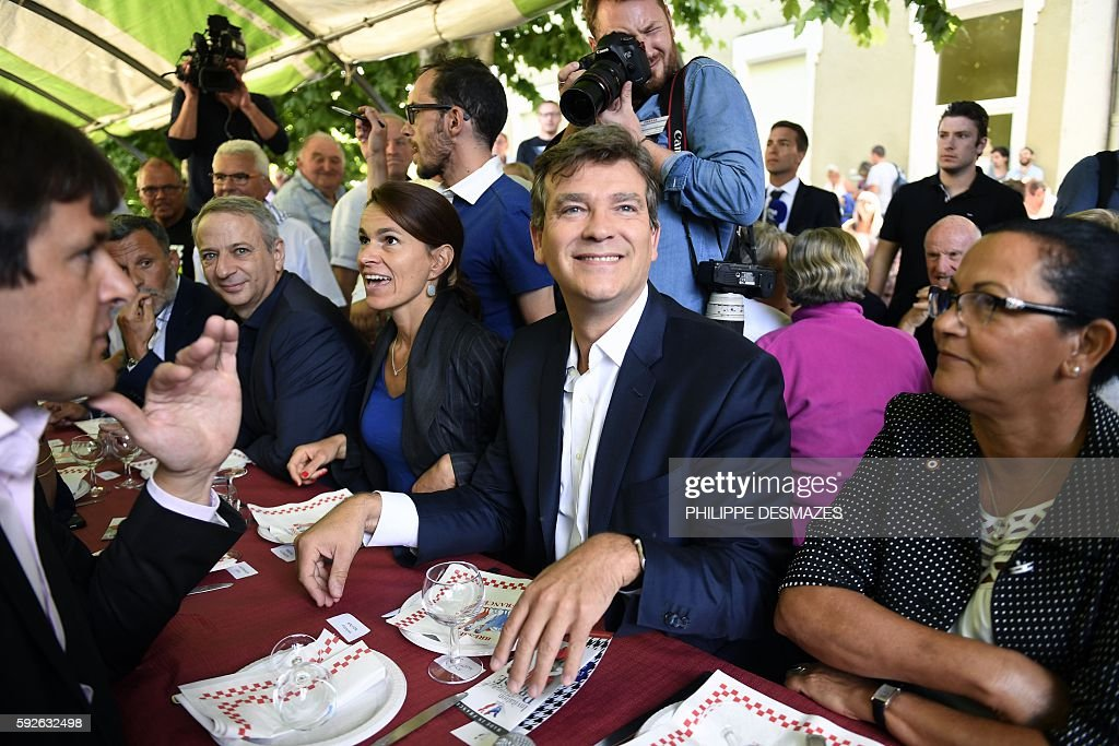 Former French Minister Arnaud Montebourg smiles next to nd Former French Minister of Culture Aurelie Filippetti at the 44th annual Fete de la Rose...