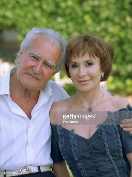Former French minister Georges Fillioud stands with his wife actress Daniele Evenou