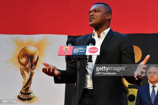 Former French National football player Marcel Desailly speaks as Russian Deputy Prime Minister and LOC chairman Vitaly Mutko looks on during the FIFA...