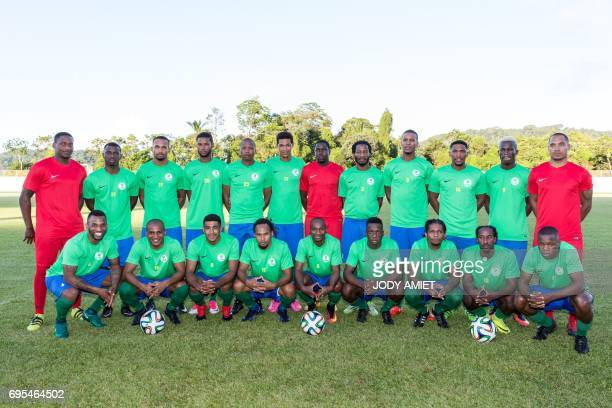 Former French national football team midfielder Florent Malouda poses for a team photo with his fellow teammates of the 'Yana Doko' French Guiana's...