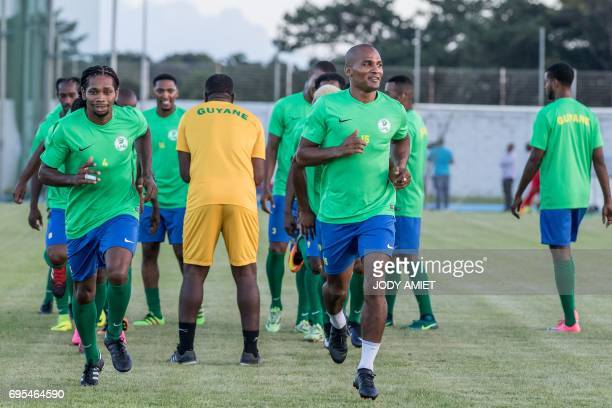 Former French national football team midfielder Florent Malouda takes part in a training session with his fellow teammates of the 'Yana Doko' French...