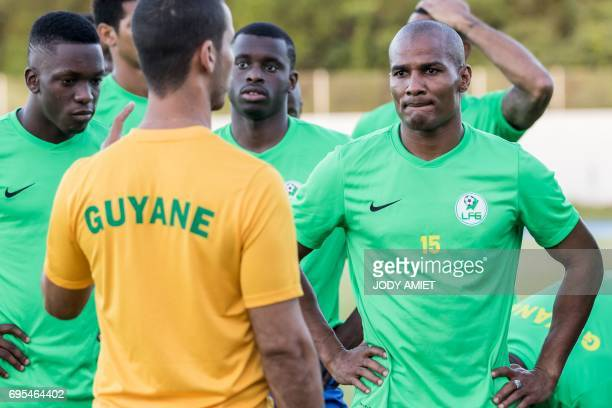 Former French national football team midfielder Florent Malouda listens to coach Jair Karam as he takes part in a training session with his fellow...