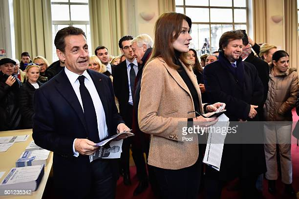 Former French President and current French rightwing opposition Les Republicains party President Nicolas Sarkozy and former French first lady Carla...
