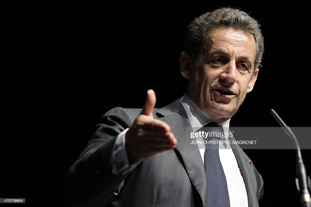 Former French president and current UMP president, <a gi-track='captionPersonalityLinkClicked' href=/galleries/search?phrase=Nicolas+Sarkozy&family=editorial&specificpeople=211375 ng-click='$event.stopPropagation()'>Nicolas Sarkozy</a>, gestures as he delivers a speech during a political meeting on April 22, 2015 in Nice, southeastern France. The vote to choose the UMP candidate for 2017 French presidential election is scheduled in November 2016. AFP PHOTO / JEAN-CHRISTOPHE MAGNENET