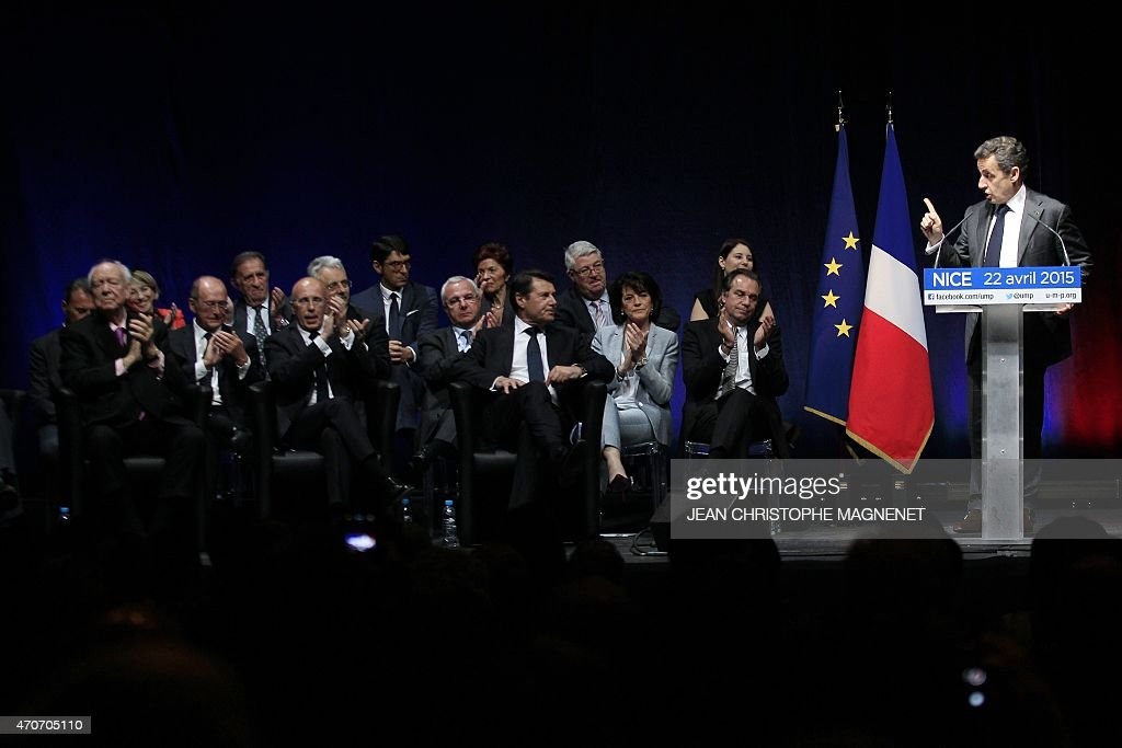 Former French President and current UMP right-wing party President, <a gi-track='captionPersonalityLinkClicked' href=/galleries/search?phrase=Nicolas+Sarkozy&family=editorial&specificpeople=211375 ng-click='$event.stopPropagation()'>Nicolas Sarkozy</a> (R) delivers a speech during a political meeting on April 22, 2015 in Nice, southeastern France as (LtoR) UMP Marseille' Mayor <a gi-track='captionPersonalityLinkClicked' href=/galleries/search?phrase=Jean-Claude+Gaudin&family=editorial&specificpeople=642983 ng-click='$event.stopPropagation()'>Jean-Claude Gaudin</a>, Claude Guibal, Eric Ciotti, Jean Leonetti and <a gi-track='captionPersonalityLinkClicked' href=/galleries/search?phrase=Christian+Estrosi&family=editorial&specificpeople=641468 ng-click='$event.stopPropagation()'>Christian Estrosi</a> applaud. The vote to choose the UMP candidate for 2017 French presidential election is scheduled in November 2016. AFP PHOTO / JEAN CHRISTOPHE MAGNENET