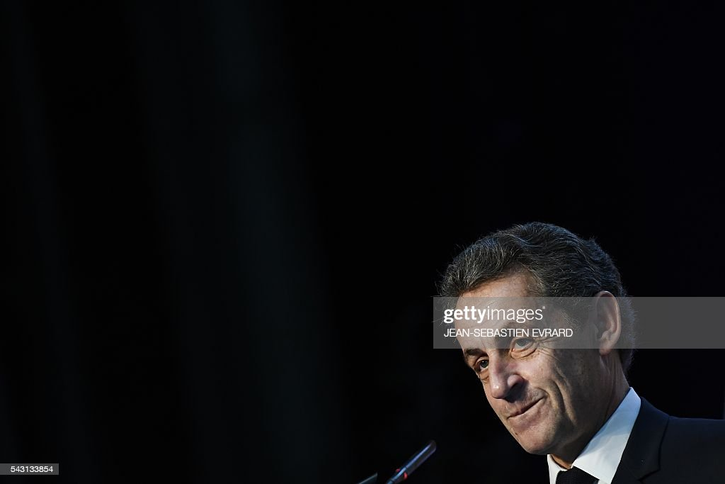 Former French president and head of the right-wing opposition party 'Les Republicains' (The Republicans) Nicolas Sarkozy reacts as he delivers a speech during a meeting for the 'Fete de la federation des Republicains - Celebration of the federation of the Republicains ' on June 26, 2016 in Chartres-de-Bretagne, near Rennes, western France. / AFP / JEAN