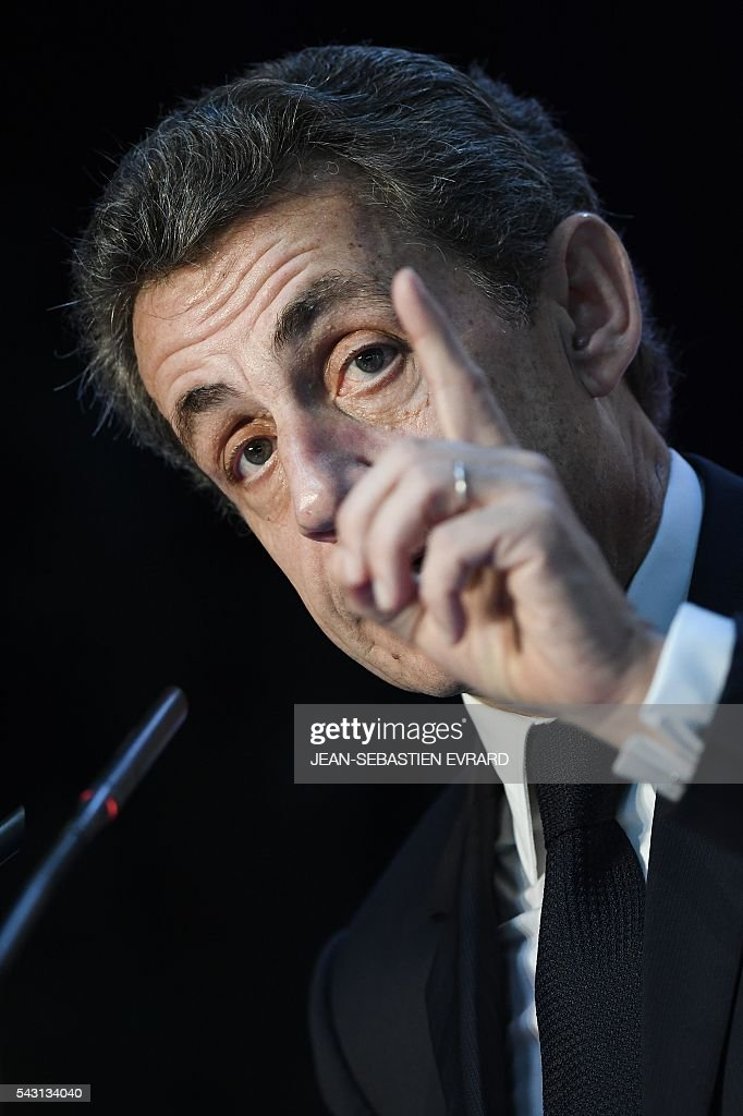 Former French president and head of the right-wing opposition party 'Les Republicains' (The Republicans) Nicolas Sarkozy gestures as he delivers a speech during a meeting for the 'Fete de la federation des Republicains - Celebration of the federation of the Republicains ' on June 26, 2016 in Chartres-de-Bretagne, near Rennes, western France. / AFP / JEAN